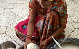 Woman making butter